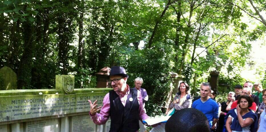 Hackney Tours talking to group by Coronation Avenue marker