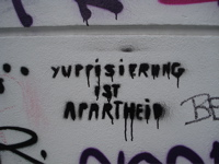 In Berlin, protective residents leave direct anti-'Yuppie' graffiti. How long they themselves have been there, we don't know...