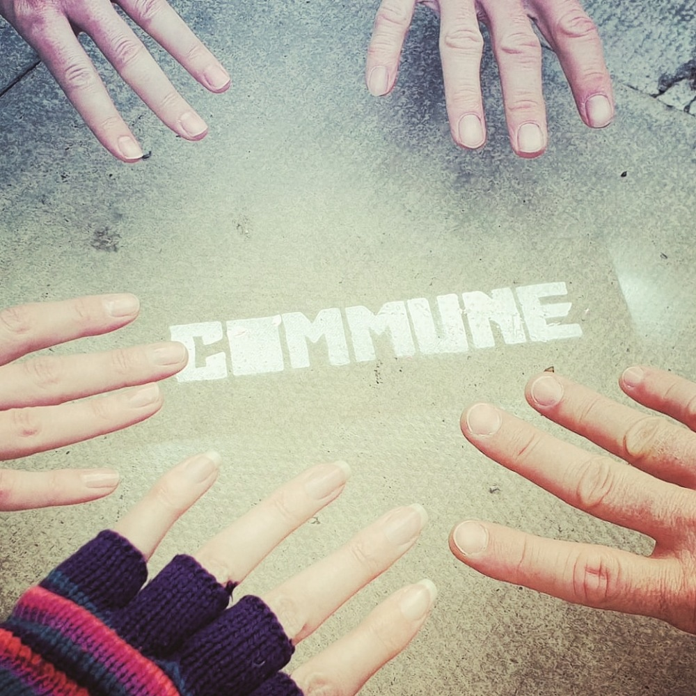 Commune Festival hands touching logo pic